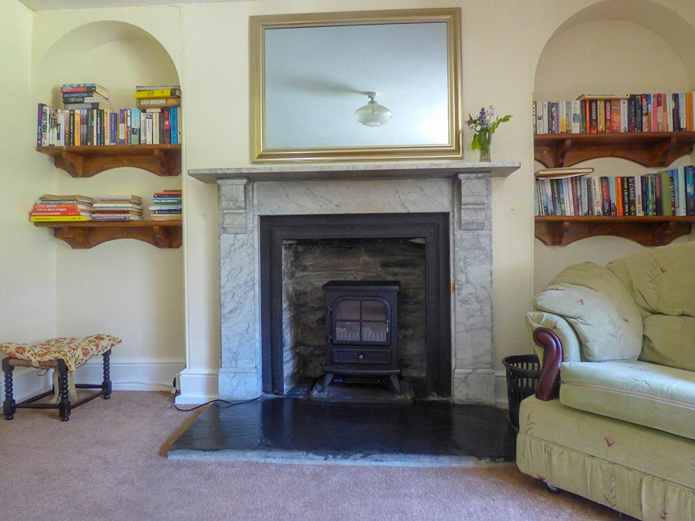 sitting room comfy games books fire