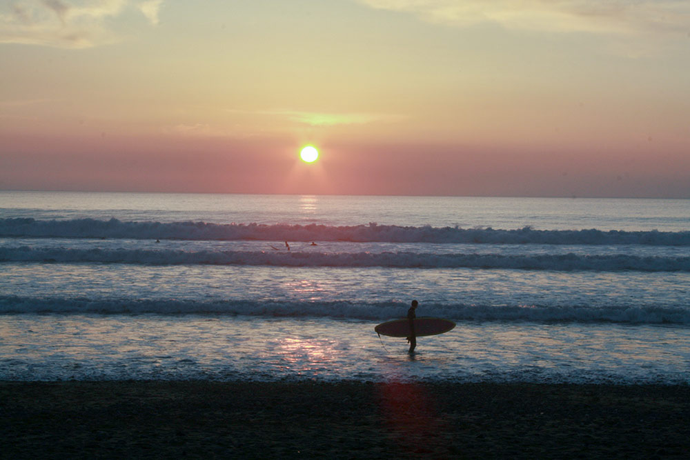 widemouth beach sunset surfer waves fun summer warm